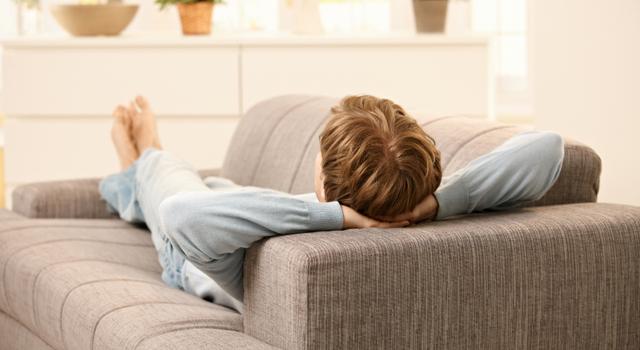 Man lying on sofa